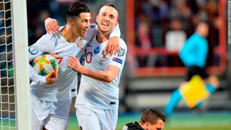 Cristiano Ronaldo (left) celebrates as he scores goal No. 99 for Portgual.