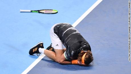 Stefanos Tsitsipas sinks to the ground after match point at the ATP Finals.