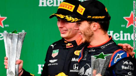 Red Bull's Dutch driver Max Verstappen (L) and Toro Rosso's French driver Pierre Gasly  celebrate with their trophies after getting the first and second place of the F1 Brazil Grand Prix, at the Interlagos racetrack in Sao Paulo, Brazil on November 17, 2019. (Photo by NELSON ALMEIDA / AFP) (Photo by NELSON ALMEIDA/AFP via Getty Images)