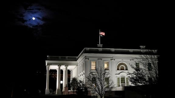 The moon shines through clouds over the White House in Washington, late Tuesday, Nov. 12, 2019. The public impeachment inquiry hearings set to begin Wednesday will pit a Democratic attorney who built his reputation as a federal mob and securities fraud prosecutor against a GOP House Oversight investigator who helped steer some of the most notable probes of the Obama administration. (AP Photo/Patrick Semansky)