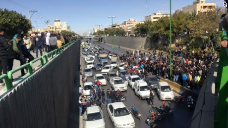 Cars block a street during a protest against a rise in gas prices, in the central Iranian city of Isfahan on Saturday, November 16.
