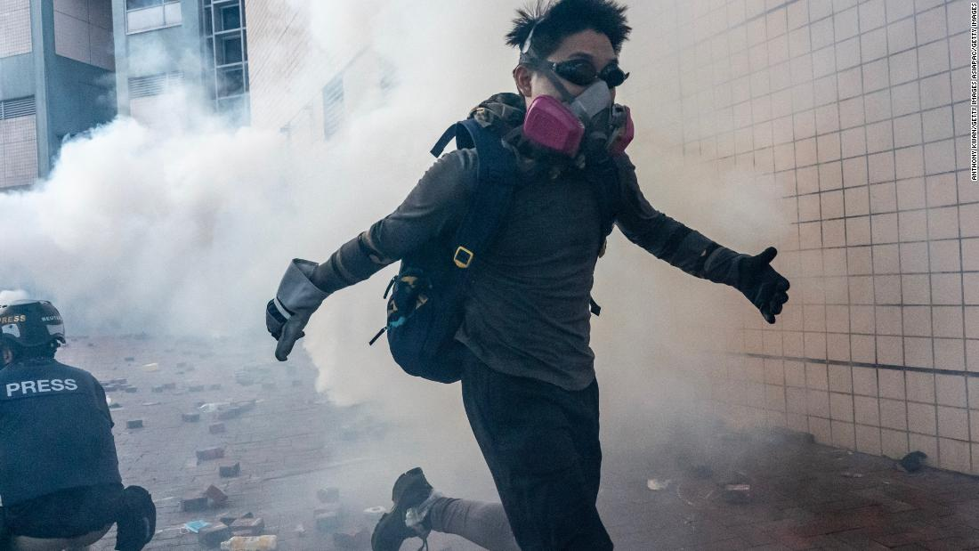 Protesters try to escape Hong Kong university after violent all-night clashes with police