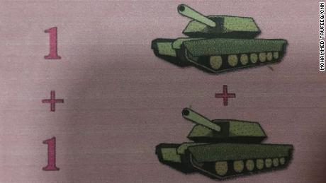 An image from a schoolbook uses tanks to teach young children to count.
