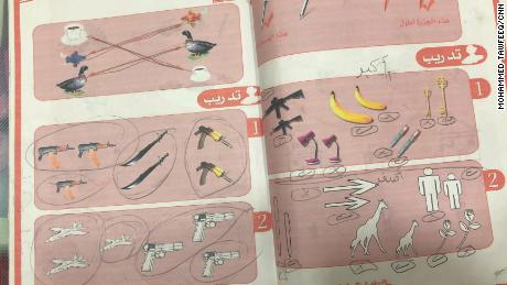 A child's textbook mixes weapons in with bananas and pens as items to count.
