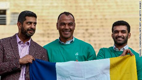 Al-Khater is joined by Brazilian two-time World Cup champion Cafu (middle) and Secretary General of the Supreme Committee for Delivery & Legacy Hassan Al-Thawadi (right).