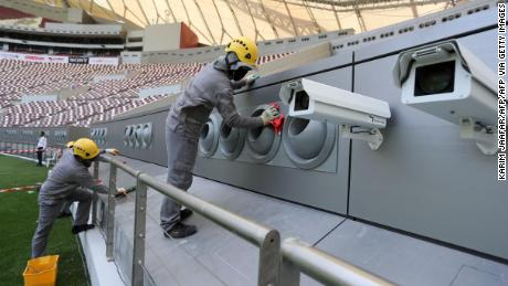 Workers cleaning the cooling system at the Khalifa International Stadium in Doha.