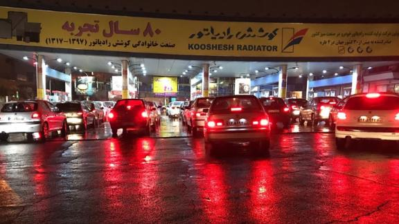 People arrive at gas stations to gas up as protests continue after the government imposed petrol rationing and raised gasoline prices in Tehran, Iran on November 18.