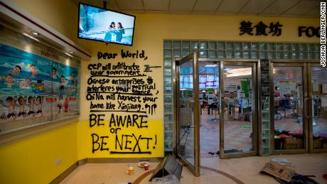 Graffiti is seen at the entrance to the canteen, which became something of a headquarters for protesters at PolyU.