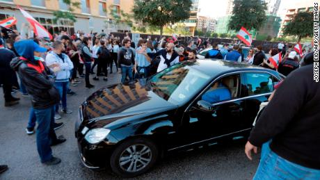 Lebanese protesters block the road before a businessman's vehicle in the capital Beirut's downtown district near parliament headquarters on November 19, 2019. - An unprecedented protest movement against the ruling elite entered its second month with the country in the grip of political and economic turmoil. The leaderless pan-sectarian movement has swept the Mediterranean country since October 17, prompting the resignation of Prime Minister Saad Hariri's government. (Photo by JOSEPH EID / AFP) (Photo by JOSEPH EID/AFP via Getty Images)