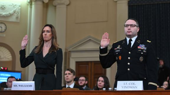 National Security Council Ukraine expert Lieutenant Colonel Alexander Vindman and Jennifer Williams, an aide to Vice President Mike Pence are sworn in before the House Intelligence Committee, on Capitol Hill in Washington, DC on November 19, 2019. - President Donald Trump faces more potentially damning testimony in the Ukraine scandal as a critical week of public impeachment hearings opens Tuesday in the House of Representatives. (Photo by Andrew CABALLERO-REYNOLDS / AFP) (Photo by ANDREW CABALLERO-REYNOLDS/AFP via Getty Images)