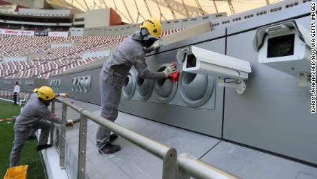 Workers cleaning the cooling system at the Khalifa International Stadium in Doha after it was refurbished ahead of the Qatar 2022 FIFA World Cup.
