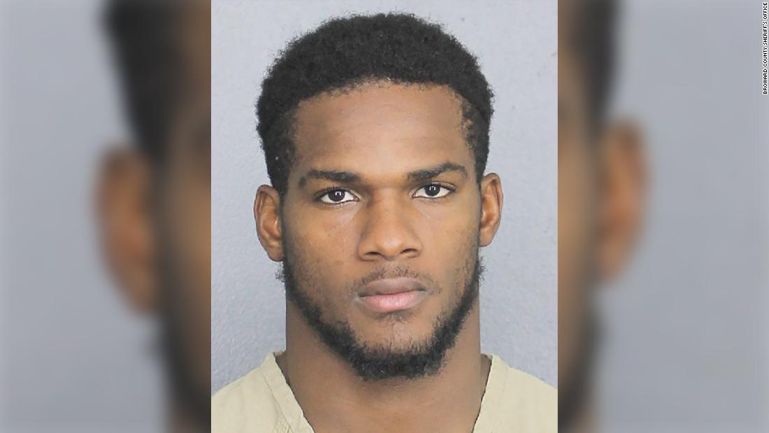 Miami Dolphins cut running back after he's accused of punching a woman who's pregnant with his baby