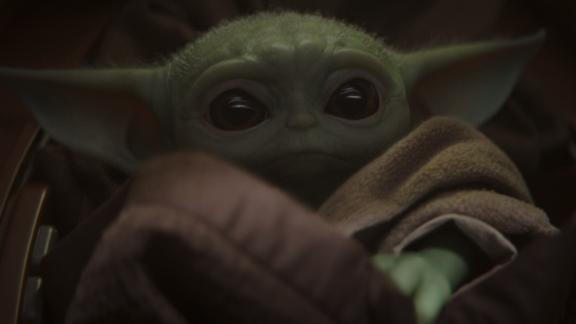 """""""The Mandalorian's"""" Baby Yoda is still new to the Disney+ streaming world, but it's already stealing hearts."""