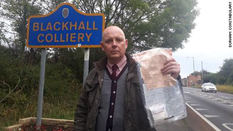 Police have solved the mysterious case of case of cash being left in a UK village.