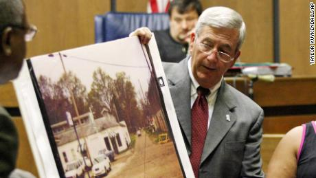 Prosecutor Doug Evans holds a photo during a trial for Curtis Flowers on June 14, 2010 in Greenwood, Mississippi.
