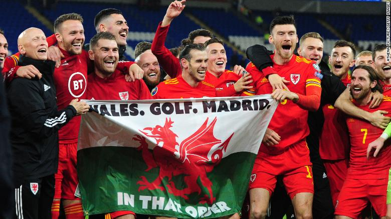 Bale and his Wales teammates celebrate at full time against Hungary.