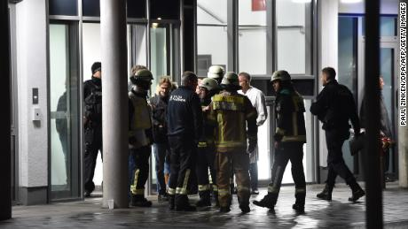 Policemen, firefighters and medical staff in front of Schlosspark-Klinik hospital in Berlin after a doctor who was giving a lecture was stabbed to death Tuesday.