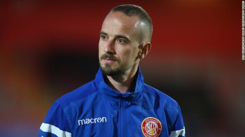 Stevenage caretaker boss Mark Sampson has been charged with using racist language.