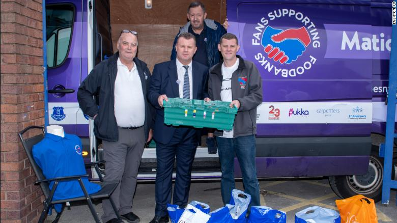 Dave Kelly (L) and former Everton player Graham Stuart collect donations outside Goodison Park.