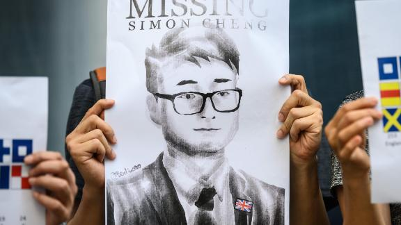 Activists gather outside the British Consulate-General building in Hong Kong on August 21, 2019, following reports that Simon Cheng, a Hong Kong consulate employee had been detained by mainland Chinese authorities on his way back to the city. - An employee of Britain's consulate in Hong Kong who went missing earlier this month is being held in China, Beijing confirmed on August 21. (Photo by Anthony WALLACE / AFP)        (Photo credit should read ANTHONY WALLACE/AFP via Getty Images)