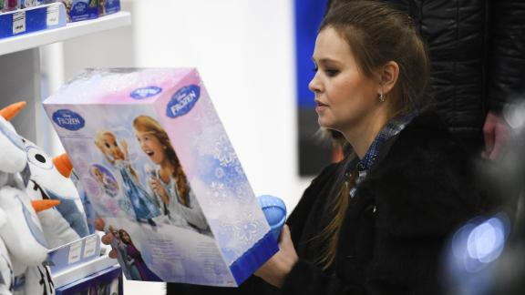 """A customer examines a """"Frozen 2"""" toy at a Disney brand toy shop, which was opened at the Central Children"""