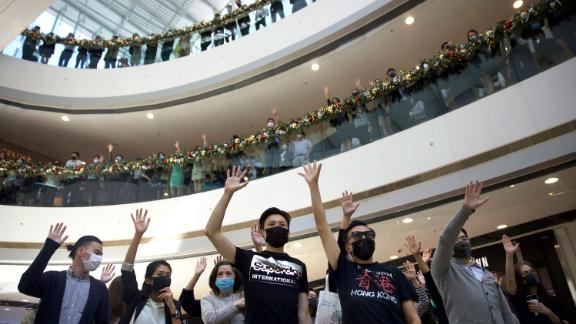 Protesters raise their hands to represent the five demands of pro-democracy demonstrators during a rally in support of the Hong Kong Human Rights and Democracy Act in the U.S., at the IFC Mall in Hong Kong, on November 21.