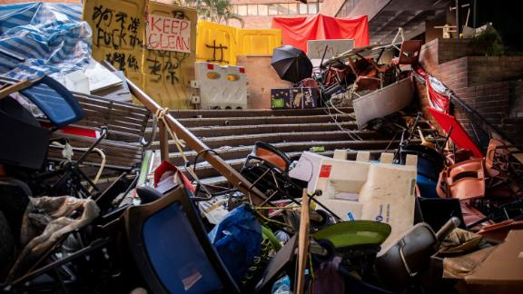 Tables and chairs piled up to create a barrier are left behind by protesters who barricaded themselves inside the Hong Kong Polytechnic University.