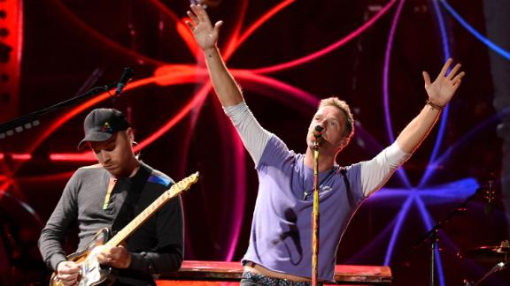 Chris Martin has revealed that Coldplay has put touring plans on hold for environmental reasons.