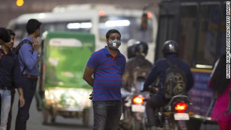People wearing pollution masks have become an increasingly common sight in Gurgaon. (Ruhani Kaur/Bloomberg/Getty Images)