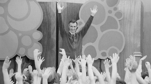 Fred Rogers entertains children during a Mister Rogers
