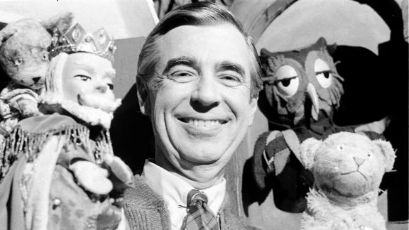 Rogers rehearsing with some of his puppet friends on the set of the show in 1984.