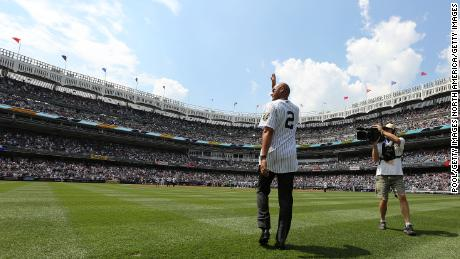 Jeter waves as he is introduced during a ceremony honoring the '96 Yankee championship.