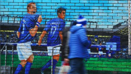 Fans walk past an Everton mural prior to the Premier League match between Everton FC and AFC Bournemouth at Goodison Park on January 13, 2019.