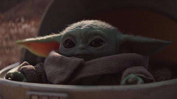 Baby Yoda, killing us with cuteness.