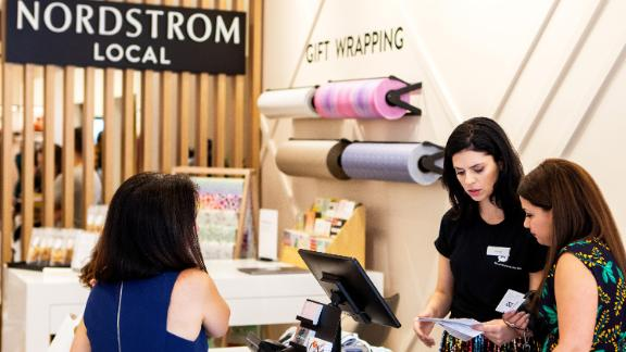 Employees assist a customer at a Nordstrom Inc. Local concept store in New York, U.S., on Thursday, Sept. 5, 2019. Nordstrom Local concept stores in Manhattan will accept merchandise returns from rivals like Macy