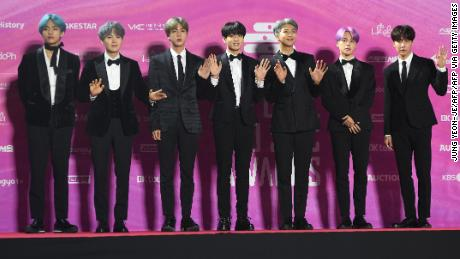 In this picture taken on January 15, 2019, South Korean boy band BTS, also known as the Bangtan Boys, pose on the red carpet at the 28th Seoul Music Awards in Seoul. - The K-pop phenomenon BTS is estimated to generate nearly 4 billion USD a year for the South Korean economy, but the boyband's seven members will still have to perform nearly two years of military service, in contrast to the likes of Tottenham Hotspurs striker Son Heung-min who had been granted a controversial exemption. (Photo by Jung Yeon-je / AFP) / TO GO WITH AFP STORY  SKOREA-DEFENCE-SOCIAL-ENTERTAINMENT,FOCUS BY KANG JIN-KYU        (Photo credit should read JUNG YEON-JE/AFP via Getty Images)