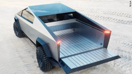 The Tesla Cybertruck's bed has a roll-down cover and a built-in ramp in the tailgate.