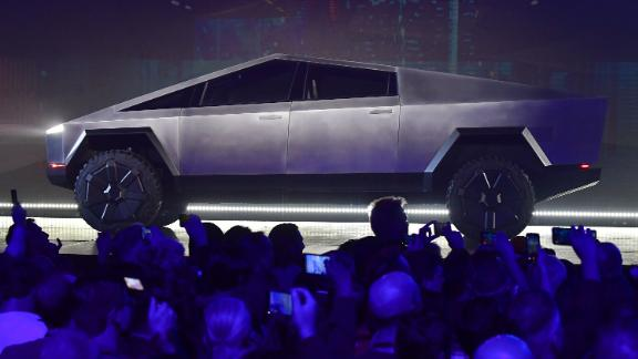 People take pictures of the newly unveiled Tesla Cybertruck.