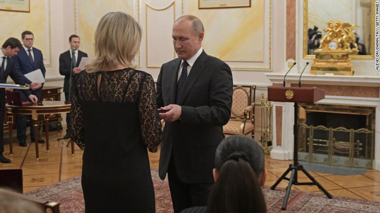 Russia's President Vladimir Putin awards Orders of Courage to the widows of the victims at a ceremony in Moscow.