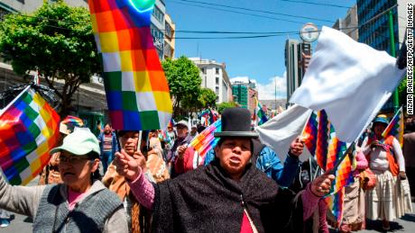 Supporters of Bolivian ex-President Evo Morales demonstrate holding Wiphala flags -representing indigenous peoples- in La Paz on November 18, 2019. - Bolivia's interim president said Sunday she will call new elections soon, as the country struggles with violent unrest a week after the resignation of Evo Morales. (Photo by AIZAR RALDES / AFP) (Photo by AIZAR RALDES/AFP via Getty Images)