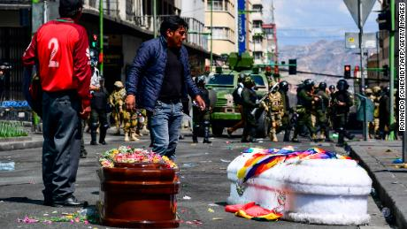 Coffins of eight victims were carried from El Alto to La Paz.