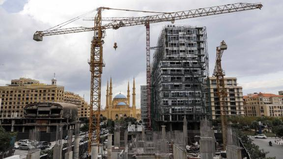 This picture taken on November 26, 2018 shows a view of a halted construction site and another still under construction in the downtown district of the Lebanese capital Beirut, with the city's landmark Mohammad al-Amin mosque seen in the background.