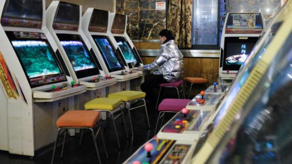 A man plays a video game at an arcade in Shanghai in February 2019.