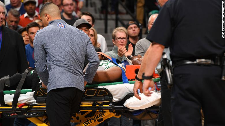 Celtics' star Kemba Walker is carried away on a stretcher after head injury Friday night in Denver.