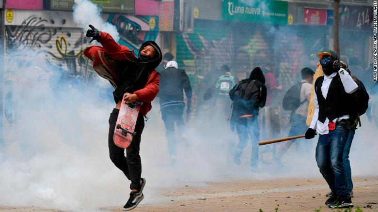 Demonstrators clash with riot police during a protest in Bogota.