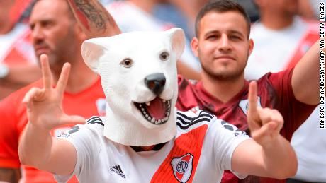 Fans of Argentina's team River Plate cheer before the start of the Copa Libertadores final.