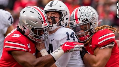 Penn State Nittany Lions quarterback Sean Clifford is sacked by Ohio State Buckeyes defensive end Chase Young linebacker Baron Browning.