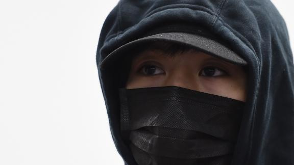 """Chow Pak-kwan, a 21-year-old protester who was shot by police at pointblank range on November 11 during a recent protest, speaks to the media in Hong Kong on November 23, 2019. - A 21-year-old Hong Kong student who was shot by police during street protests called November 23 on voters to come out in force to cast their ballots in weekend district-level elections to """"earn more democracy"""". (Photo by Ye Aung Thu / AFP) (Photo by YE AUNG THU/AFP via Getty Images)"""