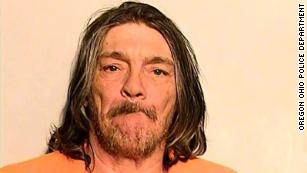 Simon Ray Lopez, 56, was arrested by Oregon, Ohio police on domestic violence charges on November 13.