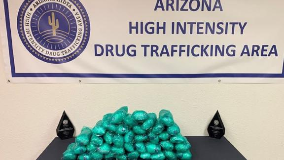 The car had three large boxes containing 43 pounds of methamphetamine, authorities said.